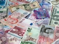 Dolár posilnil voči libre aj euru, oproti jenu však strácal